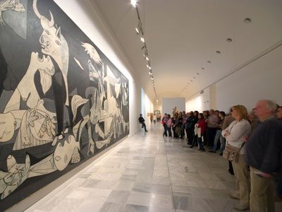 Visitors in the Reina Sofía National Art Museum looking at Picasso's Gernika