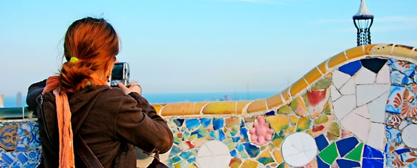 Tourist taking a picture in Güell Park, Barcelona.