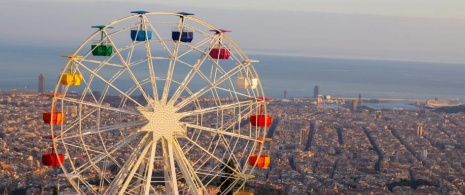 Tibidabo Ferris wheel and panoramic view of the city