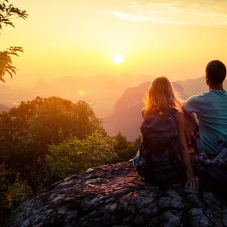 Couple watching the sunset in a natural setting
