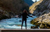 Girl enjoying the views of the river Cares in Asturias