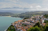 View of Lastres with the sea and Los Picos de Europa mountains in the background. Asturias