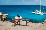 Couple gazing at the sea in the Balearic Islands