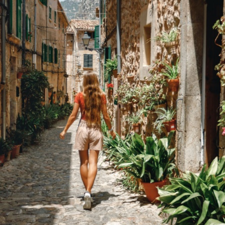 Young tourist strolling through the streets of Valldemossa, Majorca
