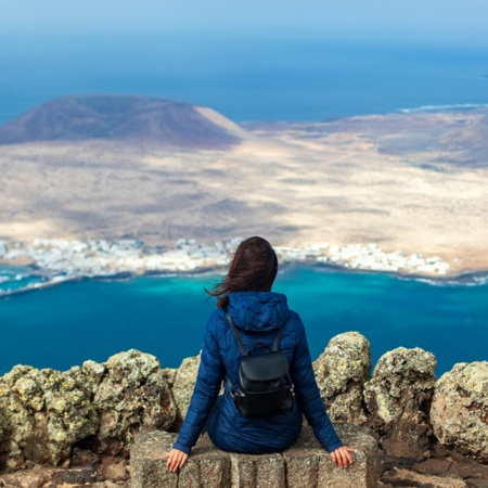 Woman admiring the scenery from the Mirador del Río viewing point. Lanzarote