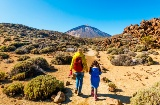 Mother and daughter walking in Teide National Park, the Canary Islands