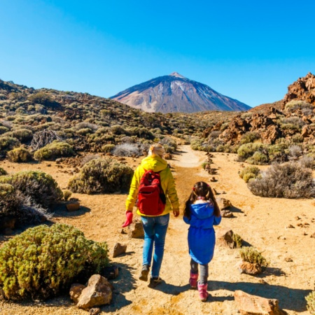 Mother and daughter walking through the Teide National Park, the Canary Islands