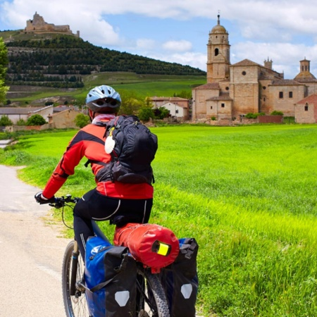 Pilgrim on a bicycle arriving in Castrojeriz (Burgos)
