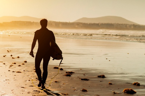 Surfer at sunset in Lanzarote