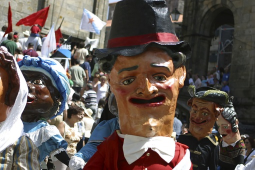 Parade of cabezudos during the Fiestas de la Ascensión