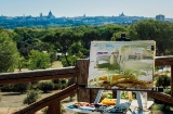 Painting with a landscape of Madrid in the background from the Retiro Park