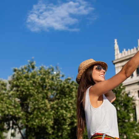 Tourist taking a selfie on Plaza Cibeles, Madrid