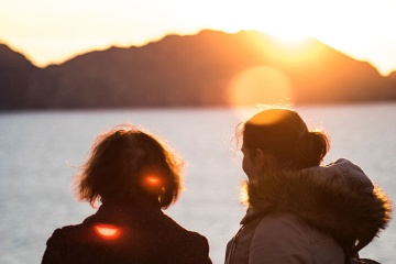 Girls watching the sun set over the Cíes Islands