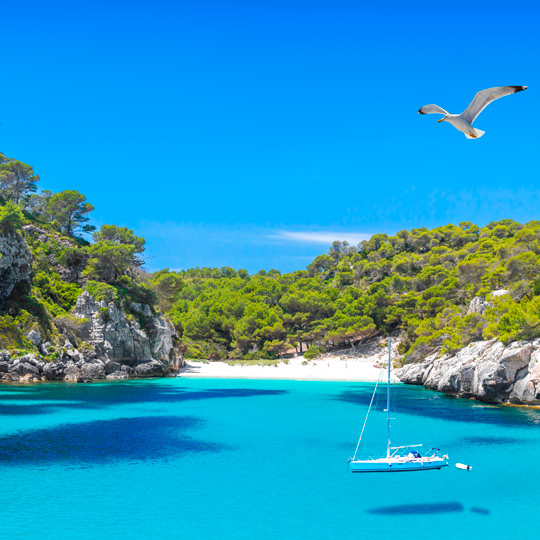 Views of the turquoise water of Cala Macarella, Menorca