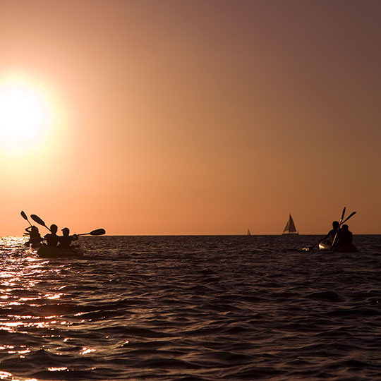 Canoeing at sunset in Formentera (Balearic Islands)