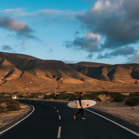 Surfer on a road in Lanzarote (Canary Islands)