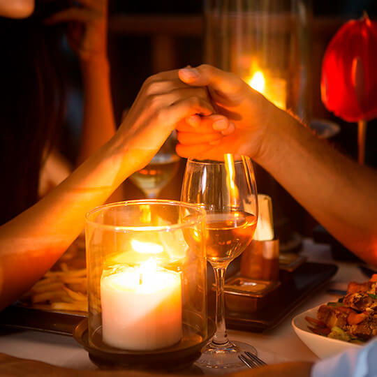 Couple dining by candlelight