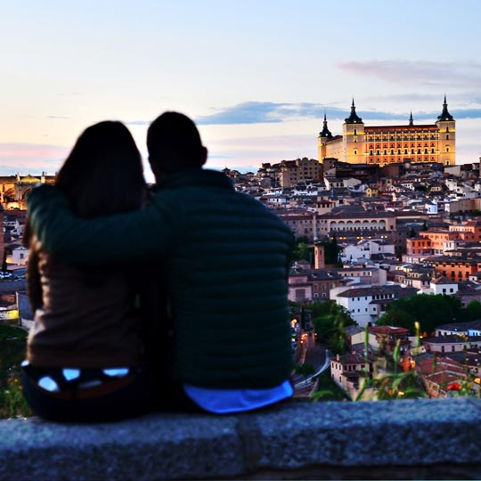 Couple enjoying the view of the city of Toledo