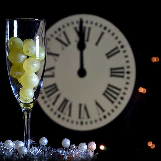 Glass with twelve grapes on New Year's Eve