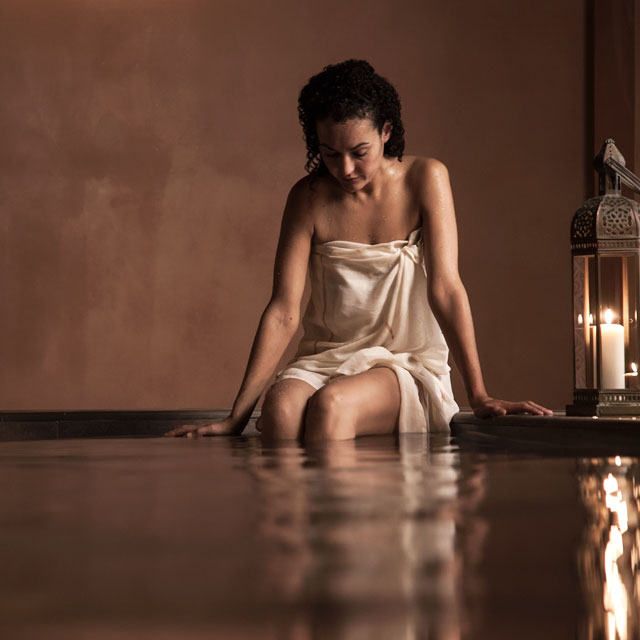 A woman relaxing in the Arab baths
