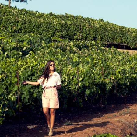 Girl walking in Tenerife vineyards