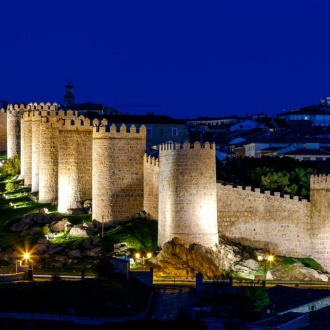 View of Avila city walls at night